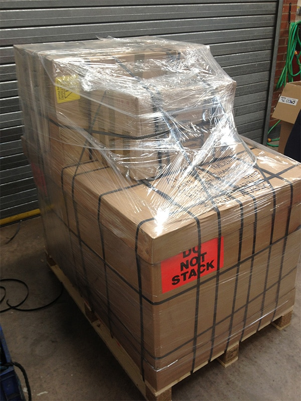 A well pallet both strapped and shrink wrapped.
